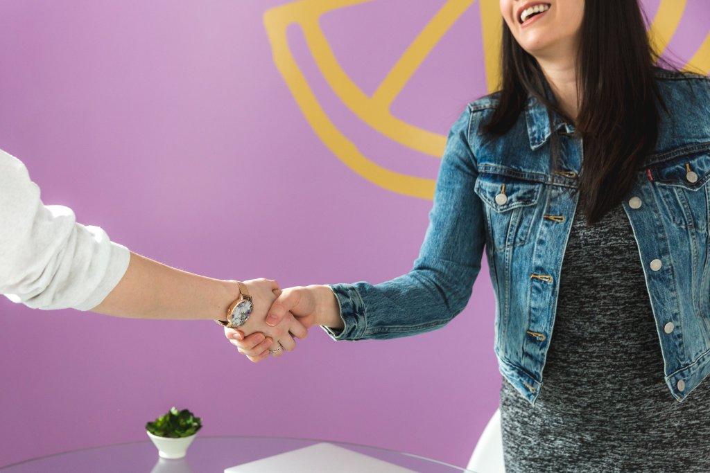 business woman shakes hand