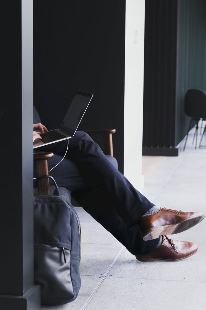 man sits with laptop