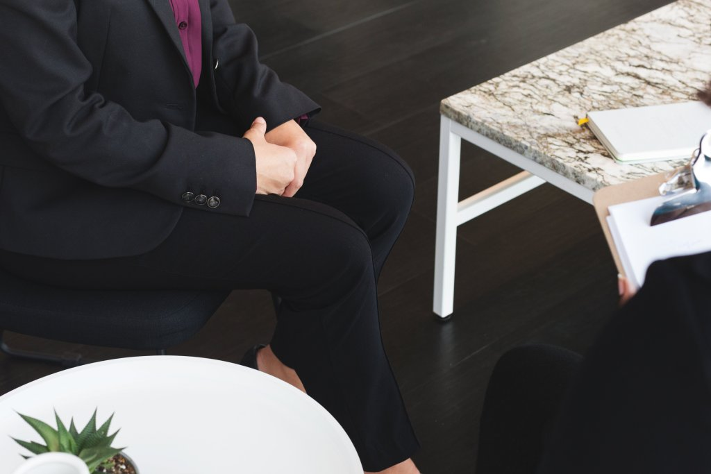 business woman sits for job interview